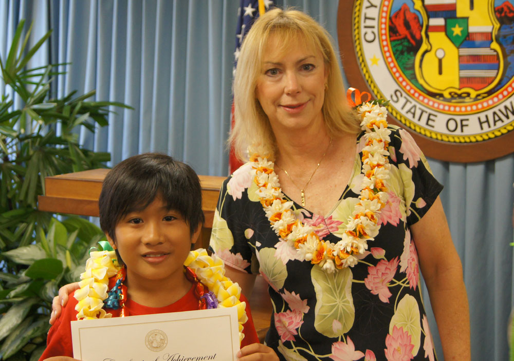 Winner of K-4th grade division, Joel Agacid , 4th grade, Ewa Elementary School pictured with he City's First Lady Judy Carlisle.