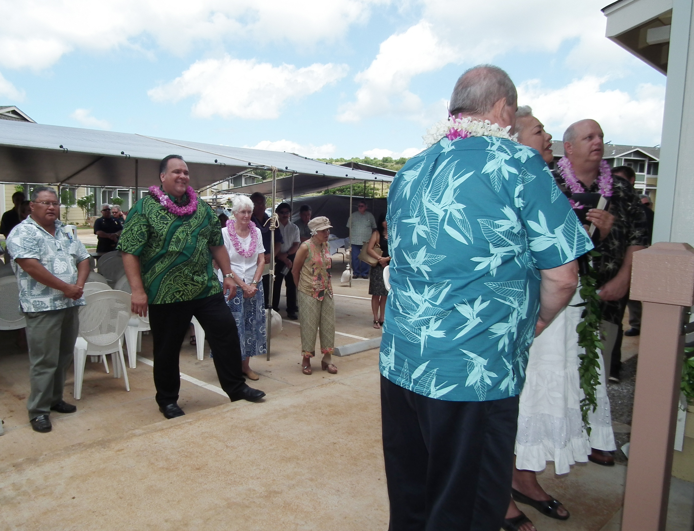 A blessing was held marking the completion of Pa'anau Village phase two. Attendees included (foreground left to right): Randy Francisco, Kaua'i Chamber of Commerce president; Mayor Bernard Carvalho, Jr.; a charter resident; Delia Valentin, Kaua'i Housing Development Corp. board member; Kaua'i County Council Chair Jay Furfaro; Rev. Ipo Kahaunaele-Ferreira; and Mark Chandler with the U.S. Department of Housing and Urban Development.