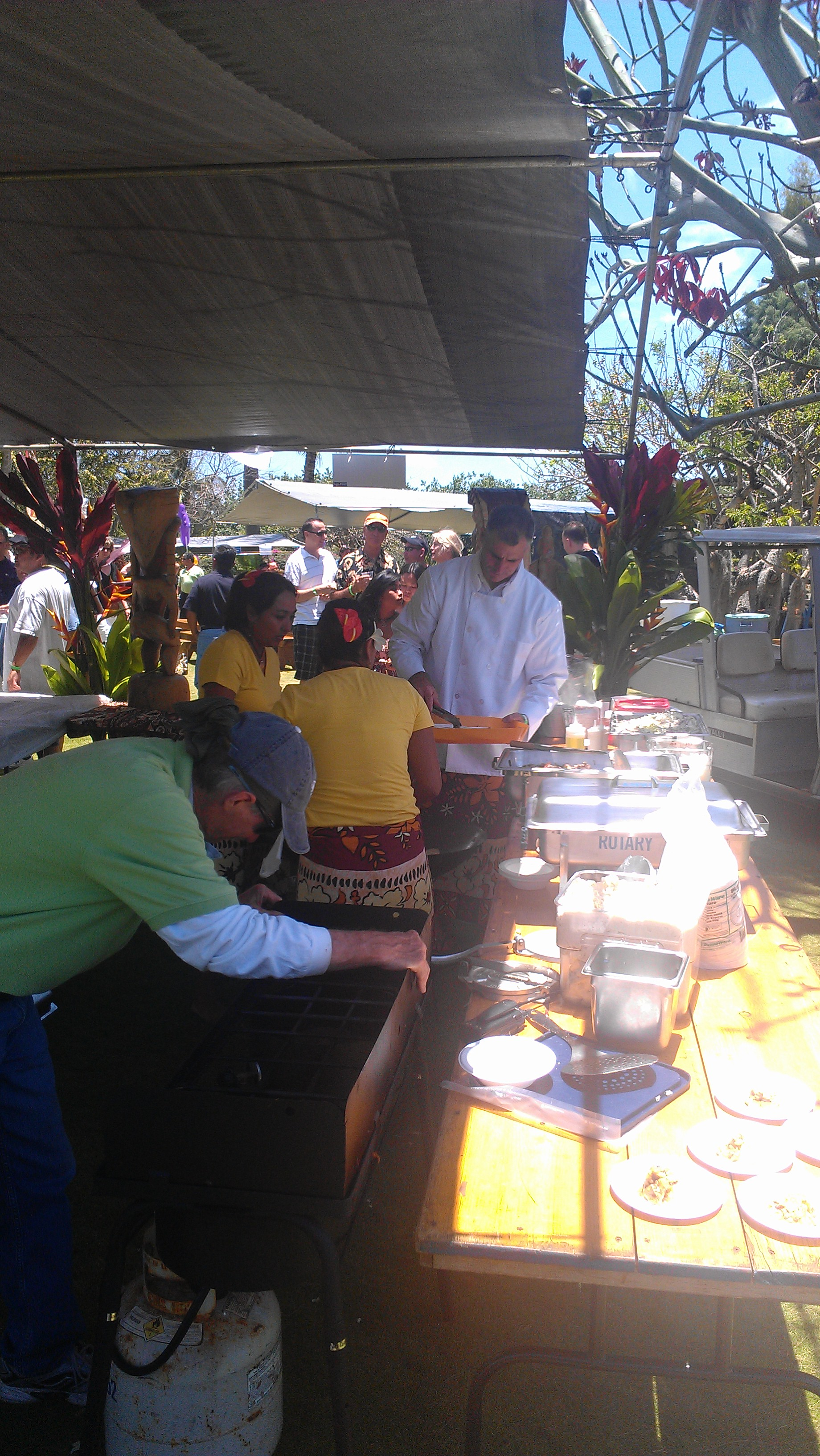 :  The boys and girls of Tiki Tacos work feverishly to feed their long line of hungry guest.
