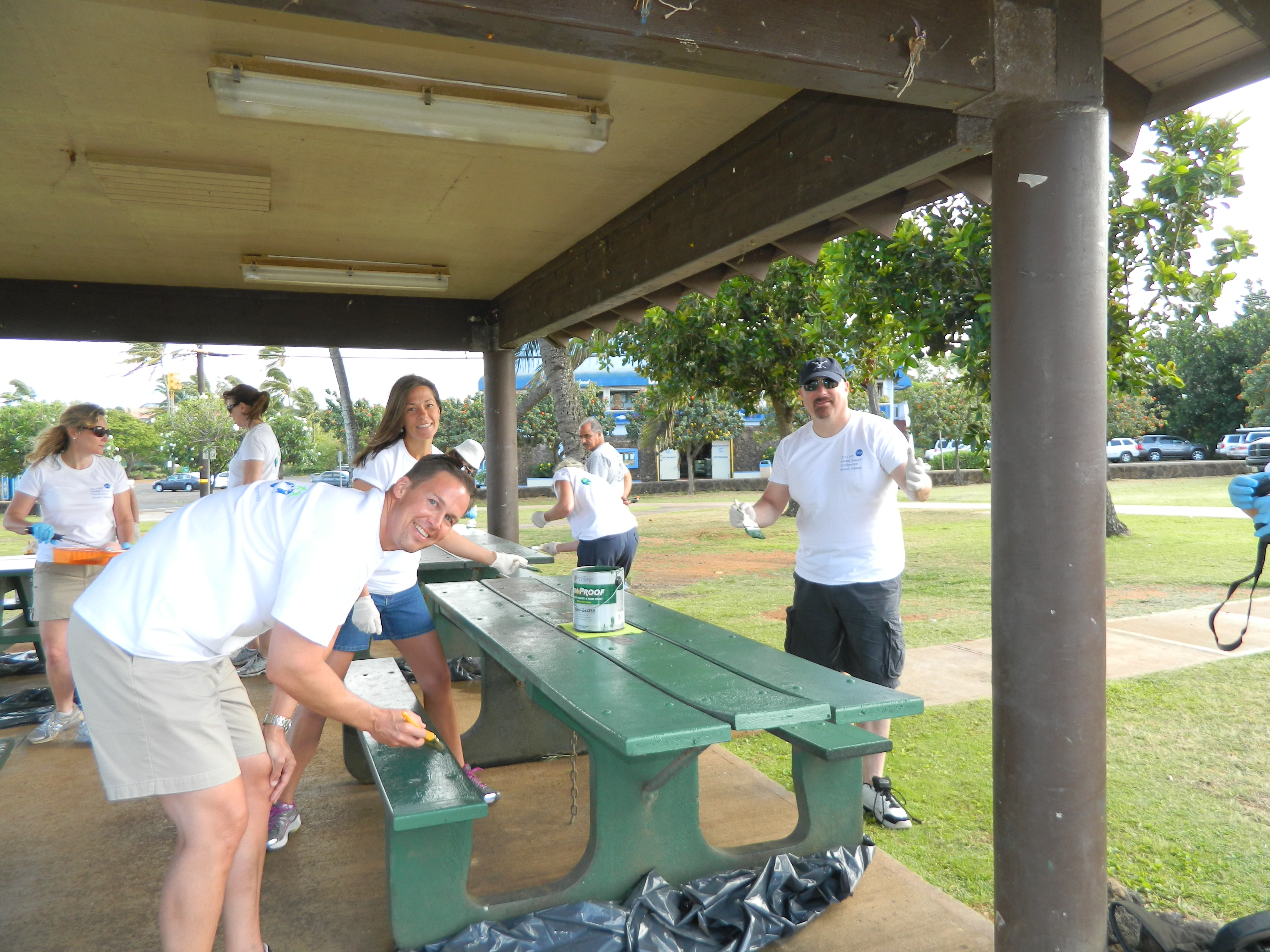 The IHS team freshens up paint on the benches at Po'ipû Beach Park