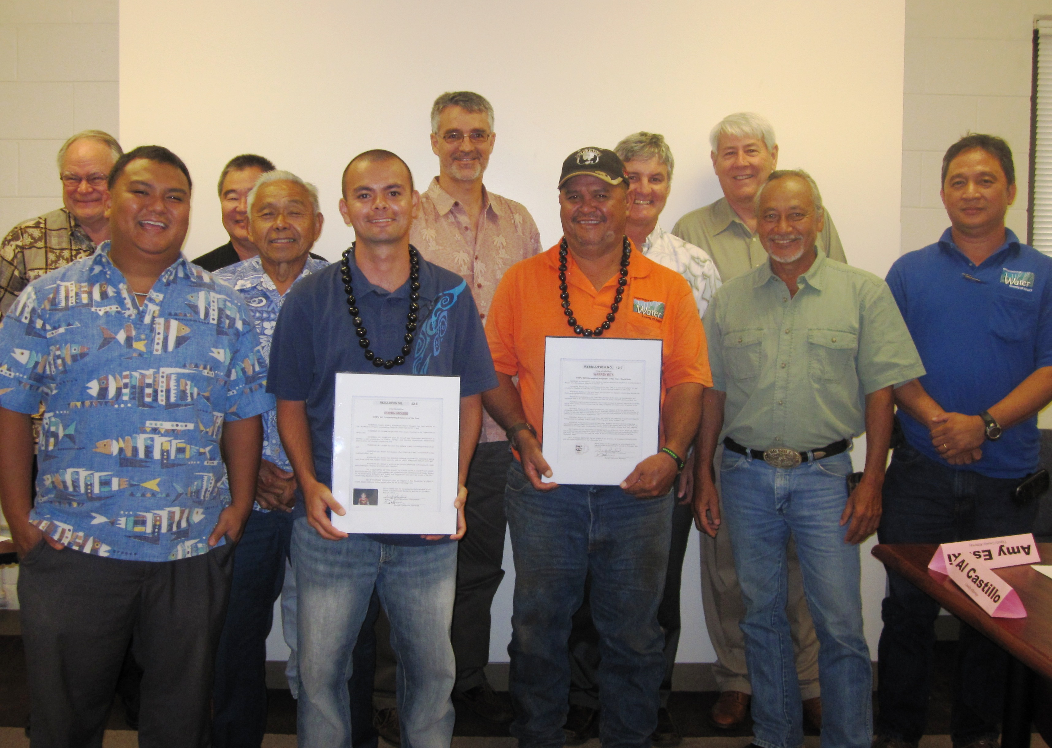 Dustin Moises and Warren Rita were recognized as the Department of Water's Outstanding Employees of the Year during the Board of Water Supply's monthly meeting. From left: Raymond McCormick; Michael Dahilig; Randall Nishimura; Roy Oyama; Moises; Lawrence Dill; Rita; William Eddy; David Craddick; Darryl Kaneshiro; and Val Reyna.