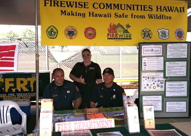 Firefighter Kalani Telles; Denise Laitinen, Firewise Communities Hawai'i coordinator; and Prevention Captain Daryl Date, helping to create a Firewise community at the 2011 Kaua'i County Farm Bureau Fair. Photo by Denise Laitinen.