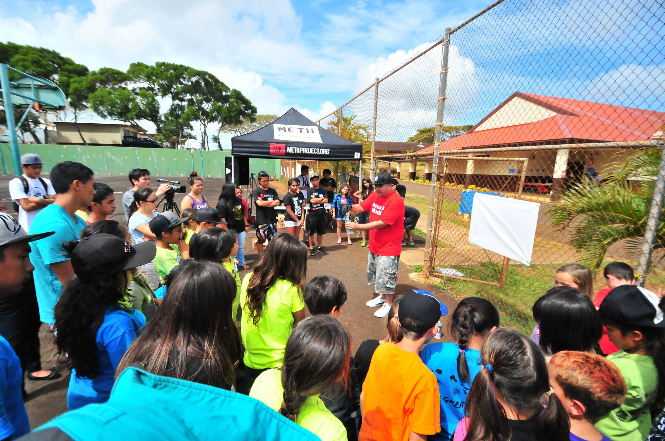 Middle and high school students from Kauai gather for a workshop on aerosol art, led by world-renowned artist, East3