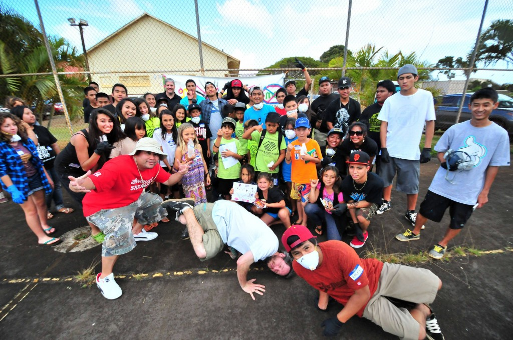 Kauai students pose with artist East3 after the completion of the first day of art workshops. Over 100 students from Kauai were registered to attend the Spray Away Meth art workshop series over the 2-day period.