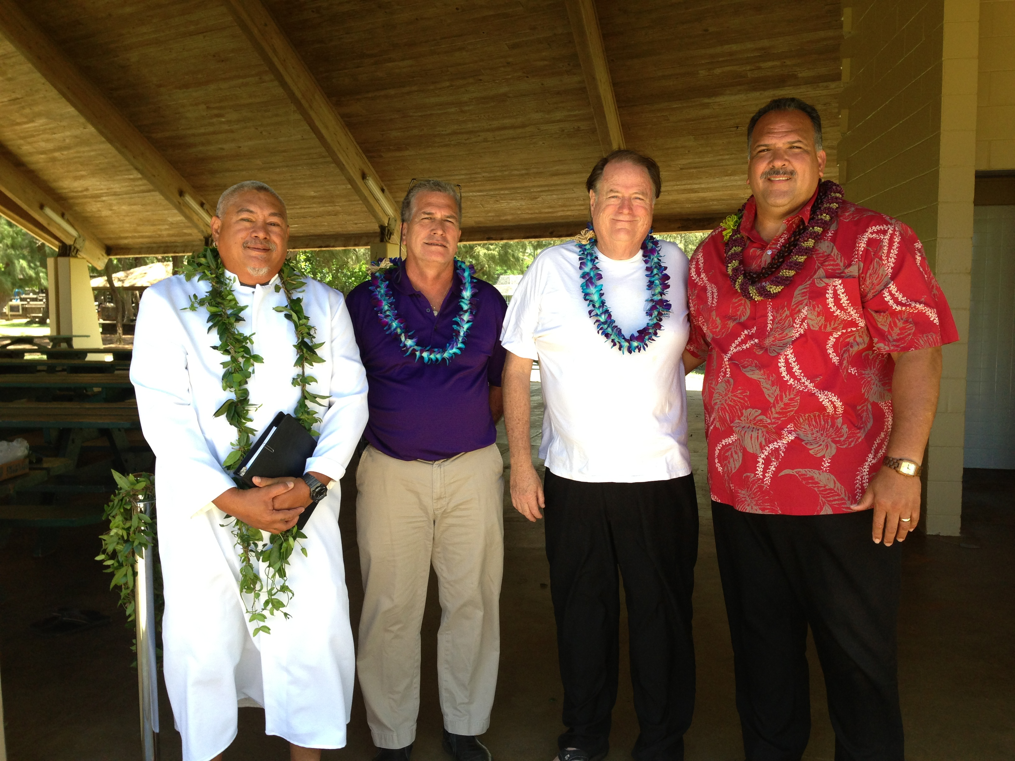 Kahu Poki Battad, Parks and Recreation Deputy Director Ian Costa, Councilman Tim Bynum and Mayor Bernard Carvalho, Jr. pose for a photo at the blessing that marked the completion of the Lydgate Park improvements project.