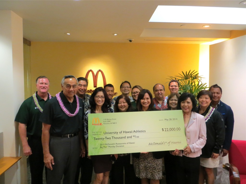 Owner-operators of McDonald's Restaurants of Hawaii with University of Hawaii Athletics Director John McNamara, UH football Head Coach Norm Chow and Na Koa Executive Director Kim Fujiuchi. Photos courtesy of McDonald's Restaurants of Hawaii.