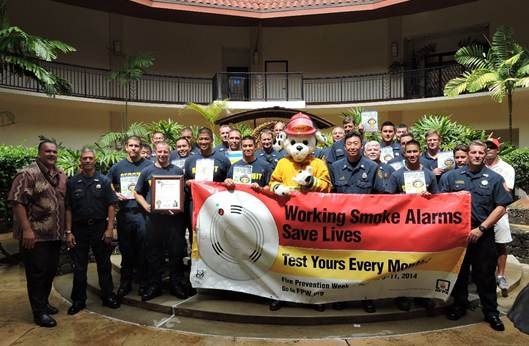 "Mayor Bernard P. Carvalho, Jr. (far left), Sparky the Fire Dog and other members of the Kaua'i Fire Department and Ocean Safety Bureau attend a Mayoral Proclamation Ceremony held at the Lîhu'e Civic Center Mo'ikeha Building to promote this year's Fire Prevention Week, Oct. 5-11. This year's theme is ""Working smoke alarms save lives! Test yours every month."""