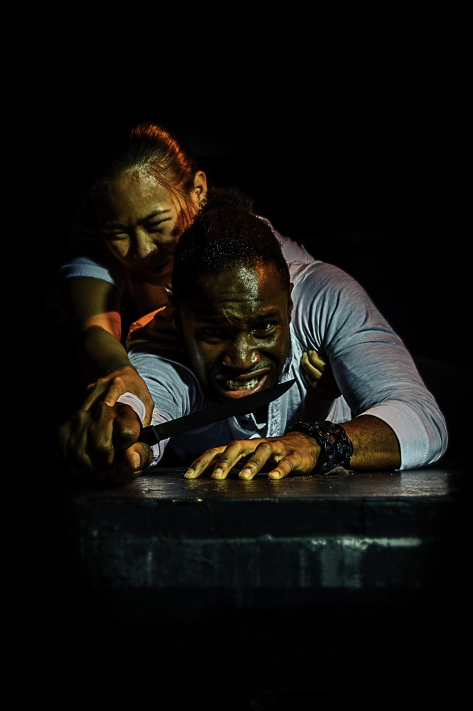 Eric Jabarri Combs struggles with Catherina Chon in Agamemnon. Photos by Daniel Mayberry.
