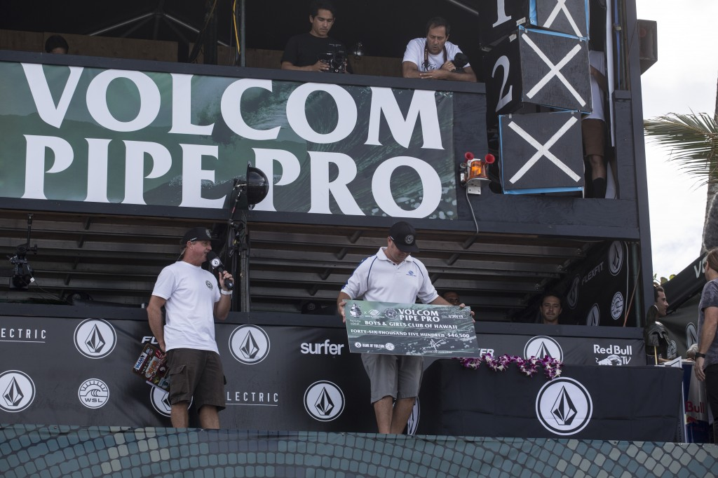President & CEO Tim Motts accepts check at Volcom Pipe Pro Awards Ceremony.