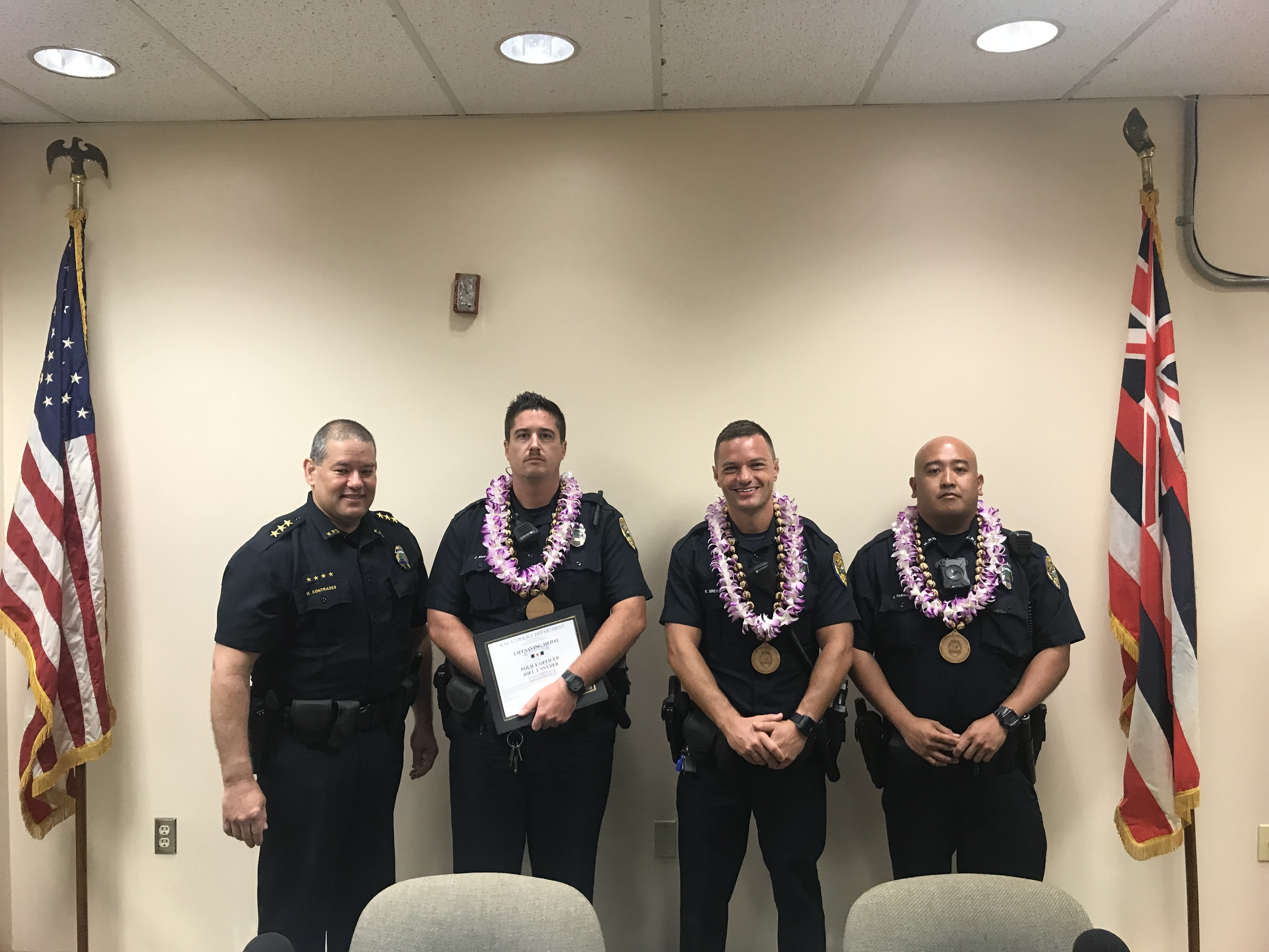 From Left to Right: Kaua'i Police Acting Chief Michael Contrades congratulates Officers of the Month Officer Joel Snyder, Officer Kristopher Breyer, and Officer Creighton Tamagawa at the Police Commission Meeting on Oct. 26.