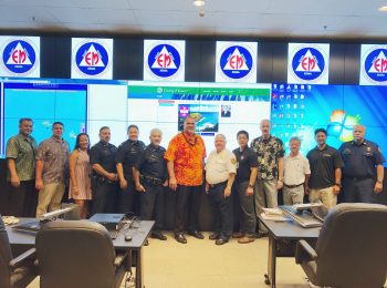 KEMA's Martin Amaro, Managing Director Wally Rezentes Jr., KEMA's Chelsie Sakai, KPD Captain Mark Ozaki, KPD Acting Assistant Chief Paul Applegate, KPD Assistant Chief Roy Asher, Mayor Bernard P. Carvalho Jr., Fire Chief Robert Westerman, KEMA Administrator Elton Ushio, IT Manager Del Sherman, Modtech's Hank Nguyen, Modtech's Shane Tsutahara, and KFD Assistant Chief Dean Lake.