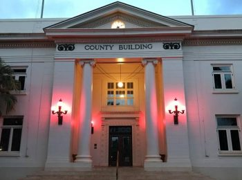 Historic County Building illuminates with pink lights in recognition of Breast Cancer Awareness Month